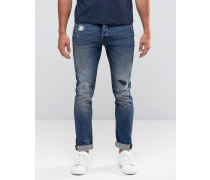 Enge Stretch-Jeans mit Rissen und Flicken Blau