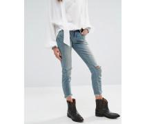 Enge Jeans mit mittelhohem Bund und Rissen an den Knien Grün