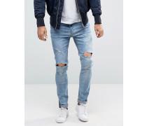 Enge Jeans in zerschlissener Optik Blau