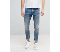 Schmal geschnittene Stretch-Jeans in starker Waschung in Hellblau Blau