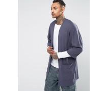 Lang geschnittene Jersey-Strickjacke in Slub-Optik Blau