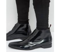 Escobar Chukka-Stiefel mit Ausstanzungen Schwarz