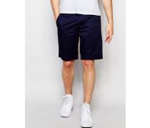 Enge Shorts mit farblich abgestimmtem Punktemuster Blau