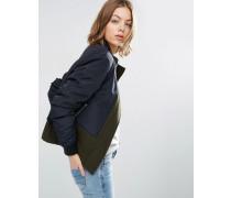Jacke aus kontrastierenden Materialien mit Stehkragen Mehrfarbig