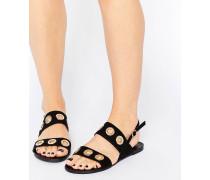 Flache Sandalen mit Ösenverzierung Schwarz
