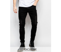 Sehr enge Jeans mit Einsätzen in verwaschenem Schwarz Schwarz