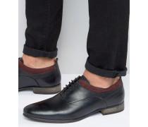 Oxford-Schuhe zum Schnüren aus schwarzem Leder mit burgunderroter Wildlederverzierung Schwarz