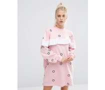 Gepunktetes Oversize-Sweatkleid mit Rüsche Rosa