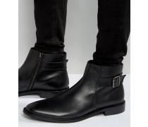 Chelsea-Stiefel mit Schnalle aus schwarzem Leder Schwarz
