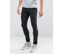 Extrem enge Jeans mit blauen Seitenbahnen in Lederoptik Schwarz