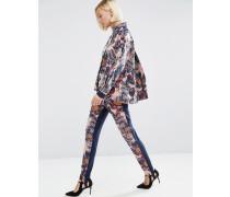 Enge strukturierte Hose mit Blumenmuster Mehrfarbig