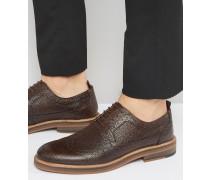 Braune Schnürschuhe aus genarbtem Leder mit dicker Sohle Braun