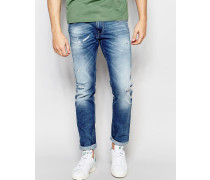 Anbass Enge Stretchjeans in mittlerer Broken Edge Extreme Distressed-Waschung Blau