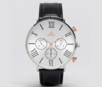 Uhr aus verschiedenen Metallen mit römischen Ziffern Schwarz