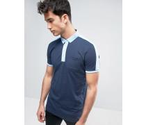Gestreiftes Polohemd mit Kontrasttasche Marineblau
