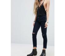 Eng geschnittene Jeans mit halbhoher Taille und Schlitz am Knie Grau