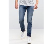 Enge, kurz geschnittene Jeans mit Patchwork-Design am Knöchel Blau
