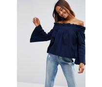 Blaues Jeansoberteil mit Schulterausschnitten und weiten Ärmeln Blau