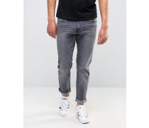 Schmal geschnittene Jeans in verwaschenem Grau Grau