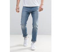 Enge Stretch-Jeans in mittlerer Waschung und in getragener Optik Blau