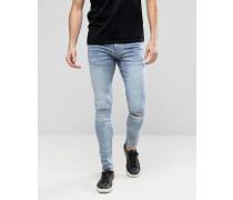 Superenge Skinny-Jeans mit Zierrissen an den Knien Blau