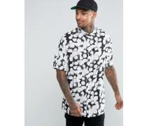 Schwarzes Hemd mit Tupfenmuster und herabfallender Schulter Schwarz