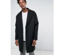 Mantel in Schwarz aus Wollmischung mit abfallenden Schultern Schwarz
