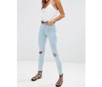 Ridley Enge, blaue Jeans mit hohem Bund und Rissen an den Knien Blau