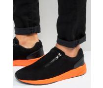 Schwarze Sneaker aus Wildlederimitat mit Reißverschluss und orangefarbener Sohle Schwarz
