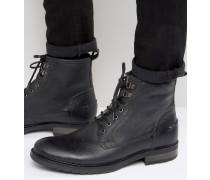 Stiefel aus schwarzem Leder mit Futter aus Lammfellimitat Schwarz