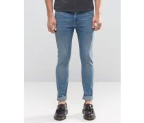 Superenge Jeans in mittelblauer Vintage-Waschung Blau