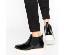 Lack-Stiefel mit flacher Plateausohle in Blockfarben Schwarz