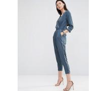 Pyjama-Overall mit Wickeldesign, schmal zulaufendem Bein und Kontrastpaspeln Grau