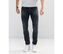 Schmal geschnittene Jeans im Used-Look Blau