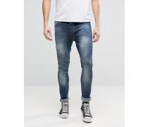 Skinny-Jeans mit Abnutzungen Blau
