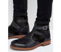 Chelsea-Stiefel aus schwarzem Leder mit Kunstfellfutter Schwarz