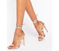 Sandaletten in Roségold-Metallic mit Knöchelriemen Gold