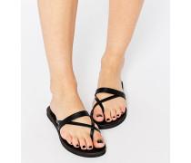 Flache Sandalen mit Zehensteg Schwarz