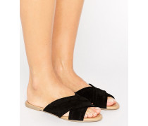 Flache Sandalen aus Wildleder mit Kreuzbändern Schwarz