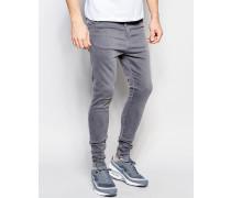 Enge Jeans mit tiefem Schritt Grau
