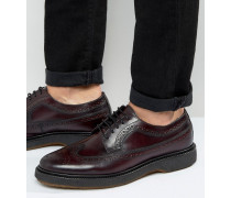 Schuhe im Budapester Stil aus burgunderrotem Leder Rot