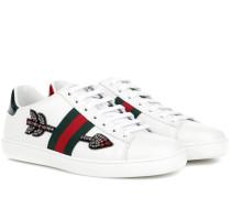 Verzierte Sneakers aus Leder und Schlangenleder