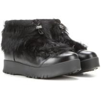 Ankle Boots aus Leder mit Fellbesatz