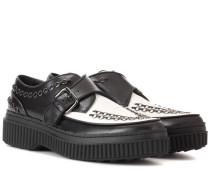 Schuhe mit Schnalle aus Leder