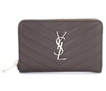 Portemonnaie Monogram Zip Around aus Leder