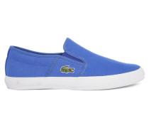 Blaue Slip-ons Rasen Sport