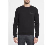 Schwarzes Sweatshirt mit Rundhalsausschnitt aus Baumwoll-Piqué mit aufgesticktem Krokodillogo