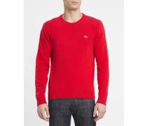 Roter Pullover mit Rundhalsausschnitt aus Schurwolle mit Brustlogo