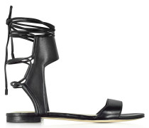 Martini flache Sandale aus schwarzem Leder mit Knöchelriemchen