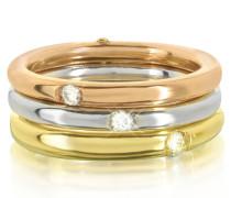 Triple Ring aus 18 Gold in weiß gelb und pink besetzt mit Diamanten